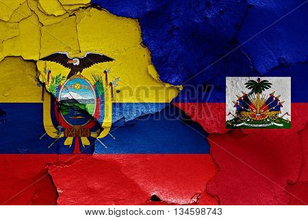Flags Of Ecuador And Haiti Painted On Cracked Wall