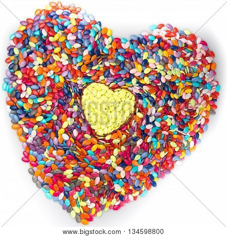 Heart Made Of Colored Smarties On A White Background.