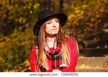Attractive Lady Sitting On Sidewalk.