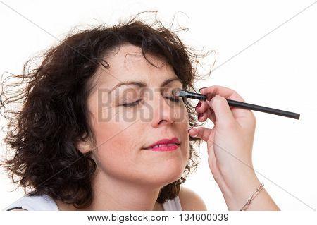 Make-up Artist Applying Eyeshadow In The Corner Of Model's Eye