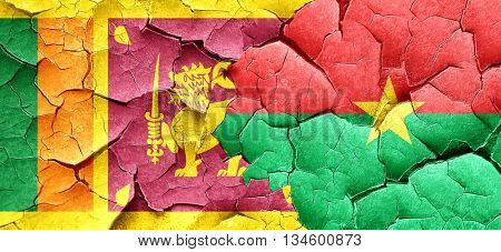 Sri lanka flag with Burkina Faso flag on a grunge cracked wall