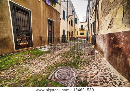 narrow street in Alghero old town Italy