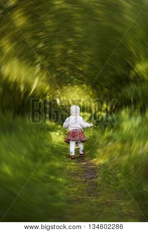small child taking its first steps into the big world