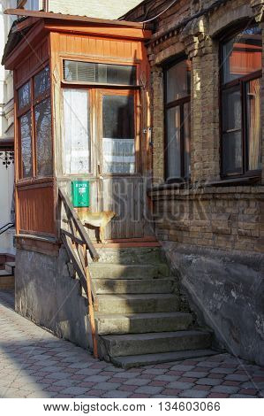 Kislovodsk, Russia - 28 February, The dog on the porch of an old house, 28 February, 2016. Architecture and streets of the city of Kislovodsk.