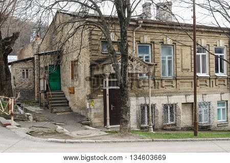 Old house with a carved porch. Architecture and attractions of the city of Kislovodsk.