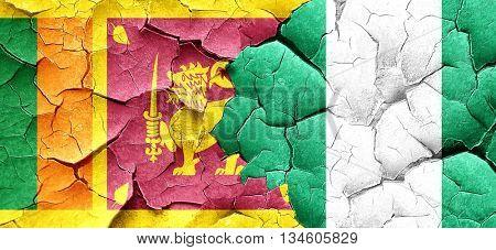 Sri lanka flag with Nigeria flag on a grunge cracked wall