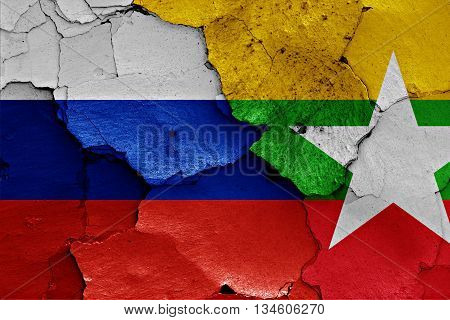 Flags Of Russia And Myanmar Painted On Cracked Wall