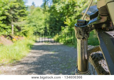 bicycle on gravel track. View on front shock absorber