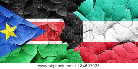 south sudan flag with Kuwait flag on a grunge cracked wall