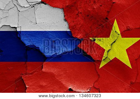 Flags Of Russia And Vietnam Painted On Cracked Wall