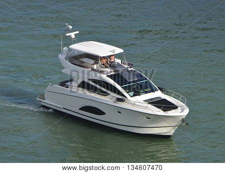 Small luxury motor yacht at idle near the port of miami,miami,florida