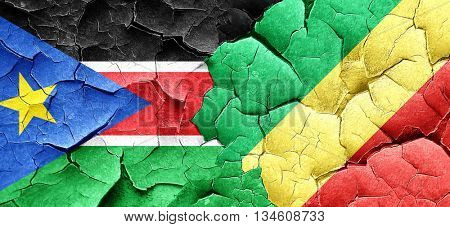 south sudan flag with congo flag on a grunge cracked wall