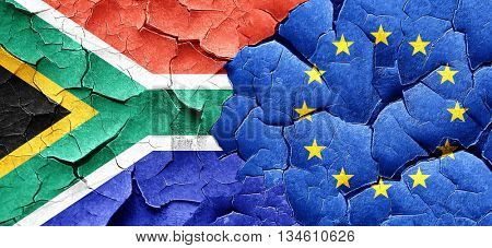 South africa flag with european union flag on a grunge cracked w