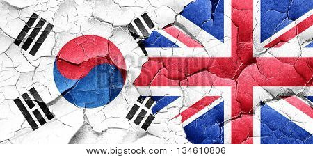 South korea flag with Great Britain flag on a grunge cracked wal