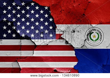 Flags Of Usa And Paraguay Painted On Cracked Wall