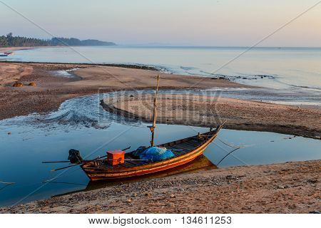 small boat on the beach in morning time thailand