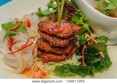 famuse street thai food deep fired fish cake with vemicilli thai food and crispy basil and sweet and spicy sauce