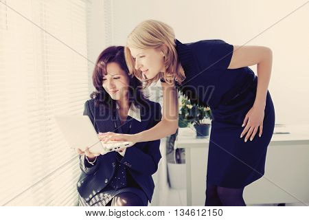 Image of teamwork in the office Business people work. Business woman in a workflow. Work days.