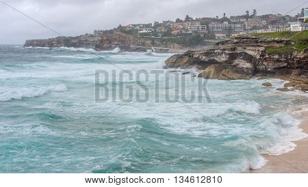 Surging waves from the Tasman Sea break upon Bronte Beach, New South Wales, Australia.