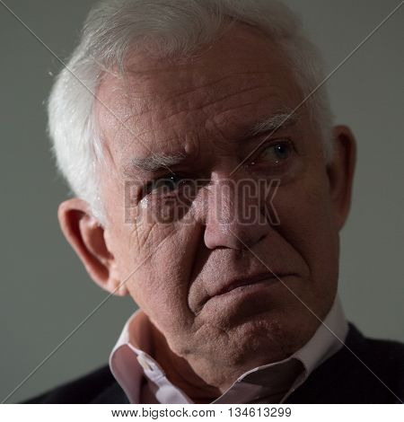 Portrait of crying elderly man with depression.