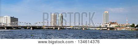 Panoramic view of modern Bangkok with skyscrapers and bridge Chao Phraya River Thailand.
