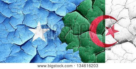 Somalia flag with Algeria flag on a grunge cracked wall