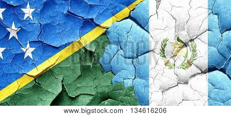 Solomon islands flag with Guatemala flag on a grunge cracked wal