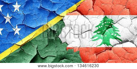 Solomon islands flag with Lebanon flag on a grunge cracked wall