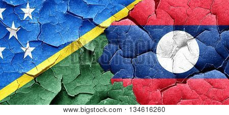 Solomon islands flag with Laos flag on a grunge cracked wall
