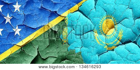 Solomon islands flag with Kazakhstan flag on a grunge cracked wa