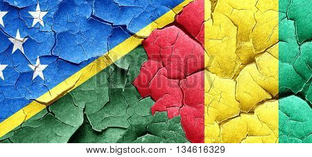 Solomon islands flag with Guinea flag on a grunge cracked wall