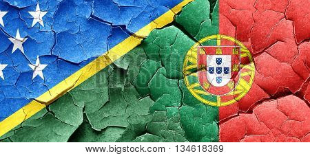 Solomon islands flag with Portugal flag on a grunge cracked wall
