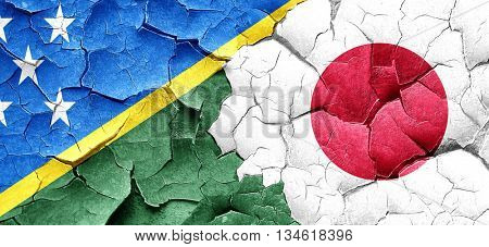 Solomon islands flag with Japan flag on a grunge cracked wall