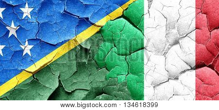 Solomon islands flag with Italy flag on a grunge cracked wall