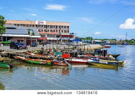Labuan,Malaysia-June 16,2016:A view of the historic town of Labuan,the Pearl of Borneo,with traditional fisherman boats lying in the harbor in the sunny day at Labuan island,Malaysia on 16th Jun 2016