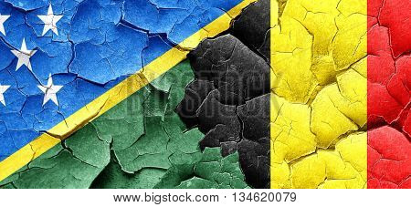 Solomon islands flag with Belgium flag on a grunge cracked wall