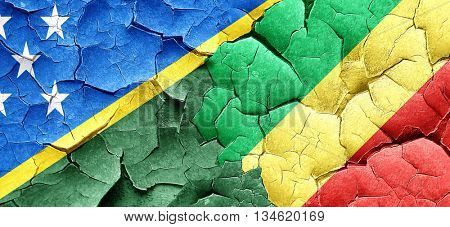 Solomon islands flag with congo flag on a grunge cracked wall