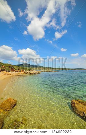 small cove under a blue sky in Sardinia Italy