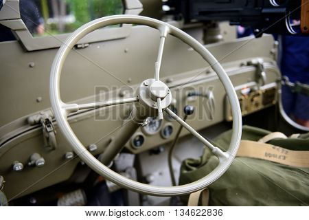 close up of a steering wheel military vehicle