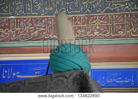 KONYA/TURKEY-June 7, 2016: Mevlana's Tomb and turban at the Mevlana Museum of Konya. June 7, 2016-Konya/Turkey