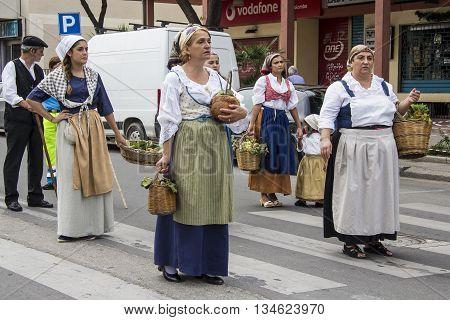 QUARTU S.E., ITALY - September 15, 2013: Wine Festival in honor of the celebration of St. Helena - Sardinia - group of women parade through the street of the city