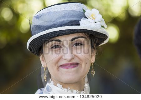 CAGLIARI, ITALY - June 1, 2014: Sunday at La Grande Jatte public gardens - Sardinia - portrait of a beautiful woman in Victorian costumes