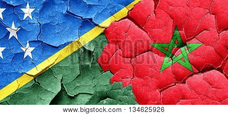 Solomon islands flag with Morocco flag on a grunge cracked wall