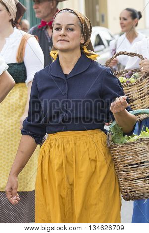 QUARTU S.E., ITALY - September 21, 2014: Parade of Sardinian costumes and floats for the grape festival in honor of the celebration of St. Helena. - Portrait of a woman in traditional Sardinian costume
