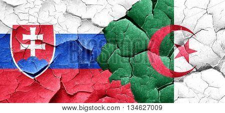Slovakia flag with Algeria flag on a grunge cracked wall