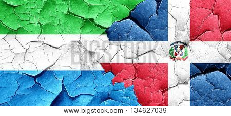 Sierra Leone flag with Dominican Republic flag on a grunge crack