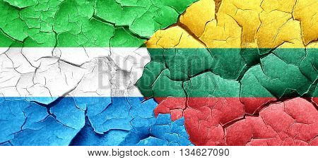 Sierra Leone flag with Lithuania flag on a grunge cracked wall