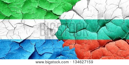 Sierra Leone flag with Bulgaria flag on a grunge cracked wall