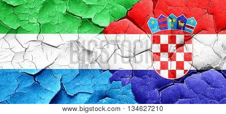 Sierra Leone flag with Croatia flag on a grunge cracked wall