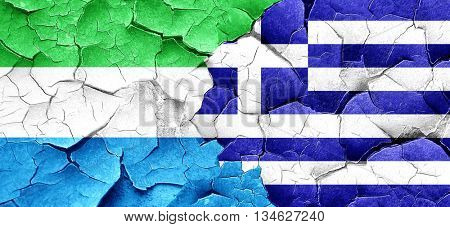 Sierra Leone flag with Greece flag on a grunge cracked wall